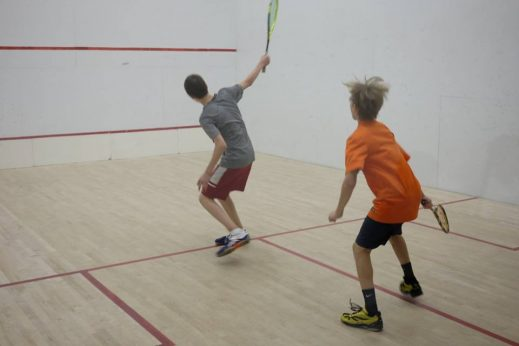 Junior playing squash